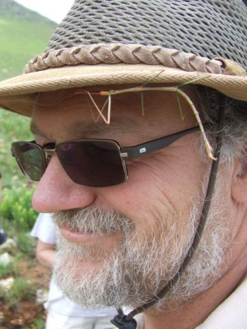 Prof Kevin Balkwill from Wits University with a stick insect keeping him company.